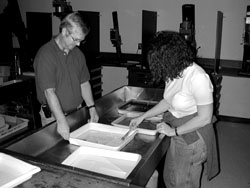 Darkroom:  Ken Stokes & Julie Holaday prepare prints for the wash